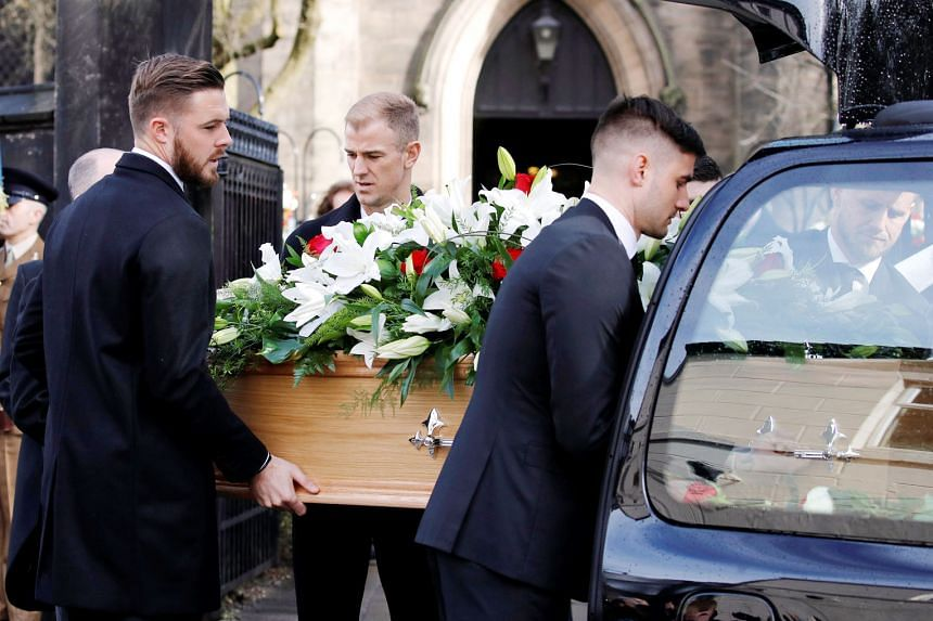 The coffin of England's World Cup-winning goalkeeper Gordon Banks being carried to the Stoke Minster church by four goalkeepers representing his three former clubs and England: Stoke's Jack Butland, Chesterfield's Joe Anyon, Leicester's Kasper Schmei