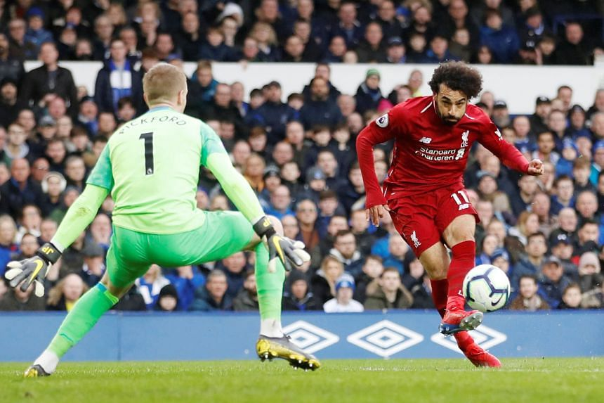 Everton's Jordan Pickford getting ready to save a shot from Liverpool's Mohamed Salah during their goal-less stalemate on Sunday. The draw was Liverpool's fourth in six games.