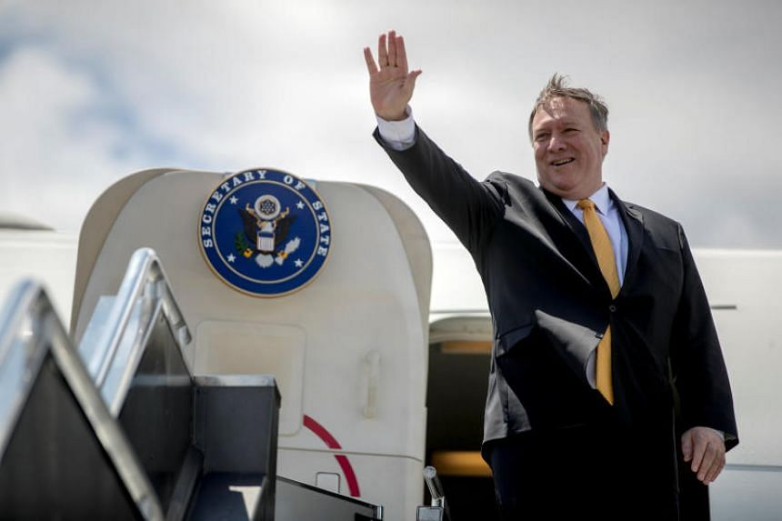 US Secretary of State Mike Pompeo boards his plane at Colonel Jesus Villamor Airbase, in Manila, Philippines, Friday, March 1, 2019.