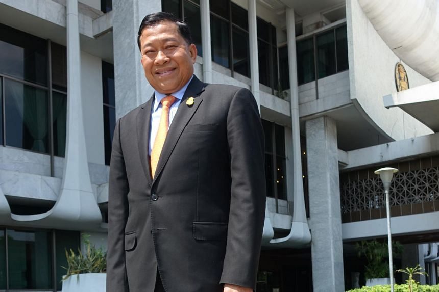 Appointed legislator Chatchawal Suksomjit standing before Thailand's parliament building in Bangkok, on March 4, 2019.