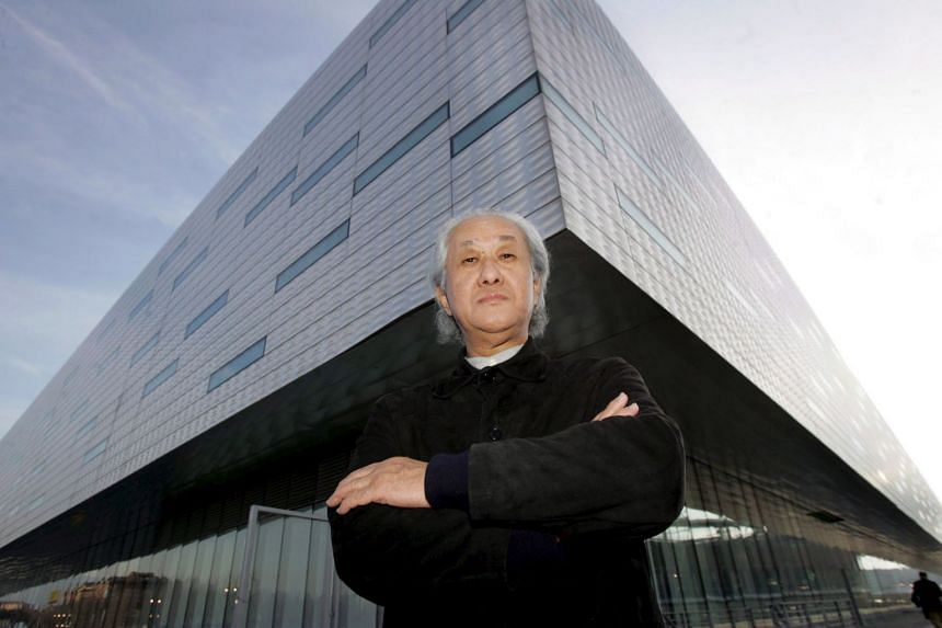 Arata Isozaki poses in front of the Palahockey palace, designed with Italian architect Pier Paolo Maggiora, in Turin, Italy, in 2005.