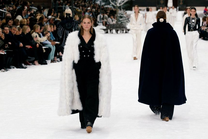 Models present creations by Chanel.