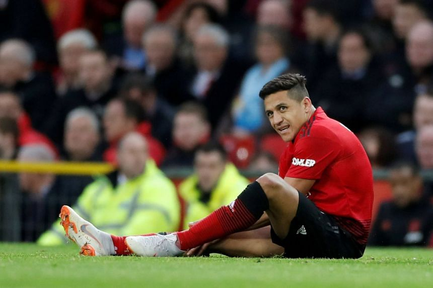 Sanchez reacts after sustaining an injury against Southampton.
