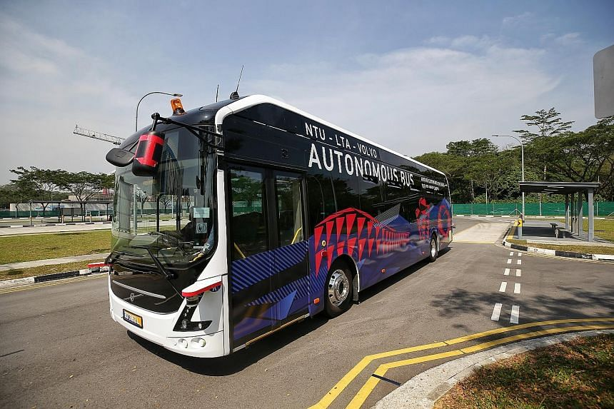 """The NTU-LTA-Volvo Autonomous Bus (top left) running on a purpose-built track at Cetran. During a trial, the bus comes to a halt (above) when an errant """"pedestrian"""" (represented by a moving dummy) is within sight. The bus is classified as having Level"""