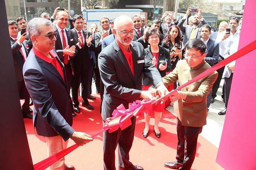 DBS chief executive Piyush Gupta officiating the opening of a new DBS branch in Mumbai. The Singapore lender is the first major foreign bank to set up a local unit in India, the world's second-most populous nation.