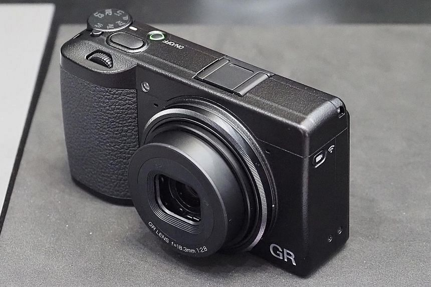 The GR III retains its famed lens but with a different optical system said to increase image quality. It also gets a touchscreen display and autofocusing is faster.