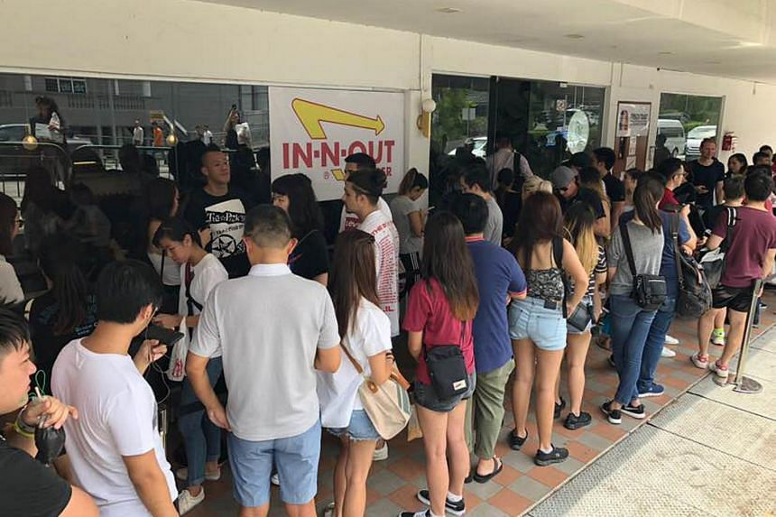 A long queue was seen during lunchtime at the In-N-Out Burger pop-up store at Columbus Cafe in Upper Thomson on Wednesday (March 6).