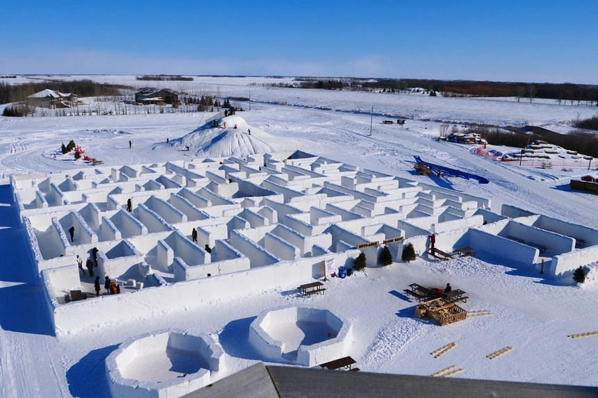 People play in a maze built by farmers Clint and Angie Masse in St Adolphe, Canada, on March 3, 2019.