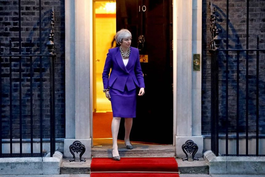 Britain's Prime Minister Theresa May waits to greet Cypriot President Nicos Anastasiades in London, on March 5, 2019.