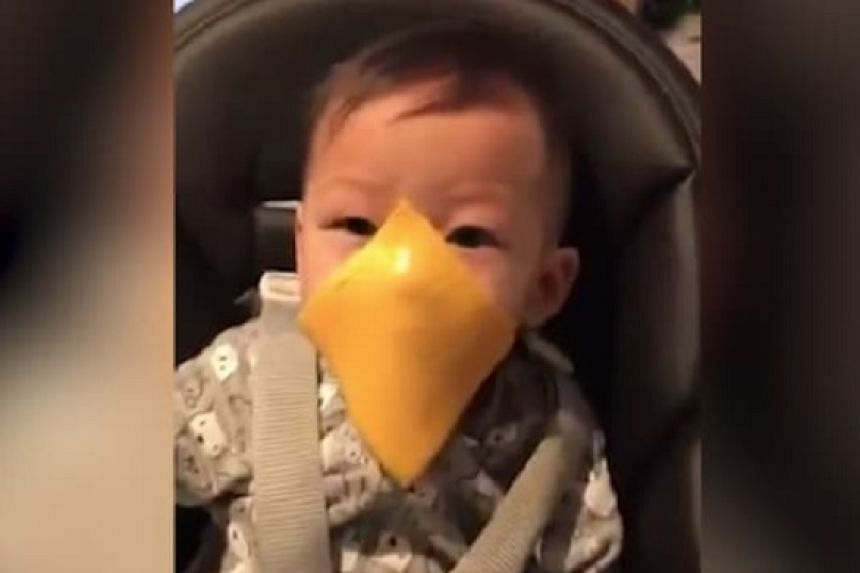"A viral phenomenon called the ""cheese challenge"" sees people toss processed cheese at unsuspecting infants."