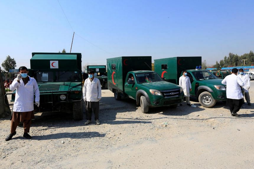 Ambulances are parked while waiting to transfer the wounded after an attack in Jalalabad, Afghanistan, on March 6, 2019.
