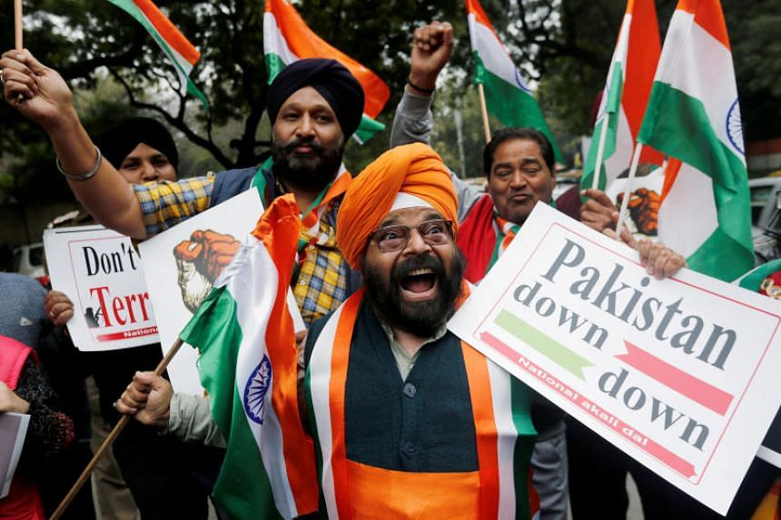 People celebrating after Indian authorities said their jets conducted air strikes on militant camps in Pakistani territory, in New Delhi, India, on Feb 26, 2019.