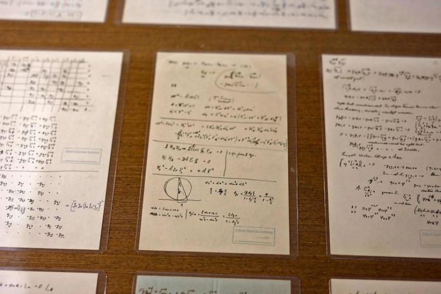 A picture taken on March 6, 2019 shows some of Albert Einstein's manuscript pages, currently on display in the Givat Ram Hebrew University of Jerusalem.