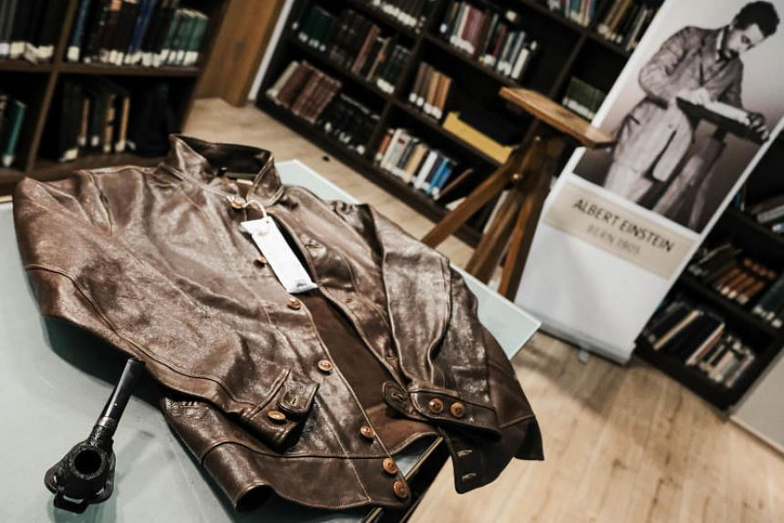 A pipe and a leather jacket that belong to Albert Einstein seen on display at the Givat Ram Safra Campus during an event to unveil manuscript pages by Einstein ahead of his 140th birthday.