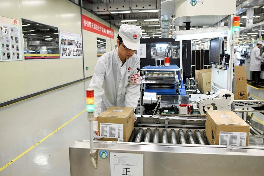 An employee works on a mobile phone production line at a Huaweiproduction base during a media tour in Dongguan, China's Guangdong province, on March 6, 2019.