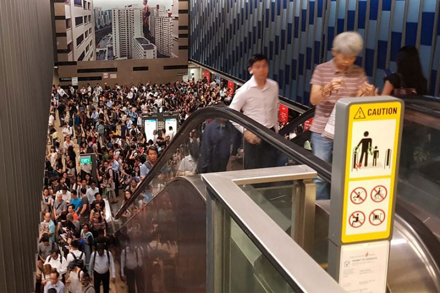 The crowd of commuters at Bukit Panjang MRT station on the Downtown Line.