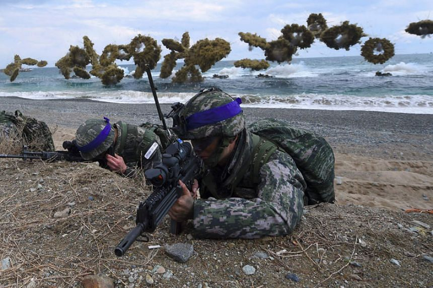 Marines taking position on a beach during a joint landing operation by US and South Korean forces in the southeastern port of Pohang, South Korea, in 2017.