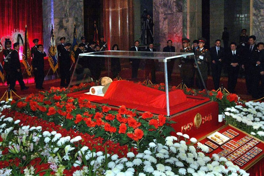 The body of North Korean leader Kim Jong Il lies in state at the Kumsusan Memorial Palace in Pyongyang in this picture released by the North's official KCNA news agency, on Dec 21, 2011.