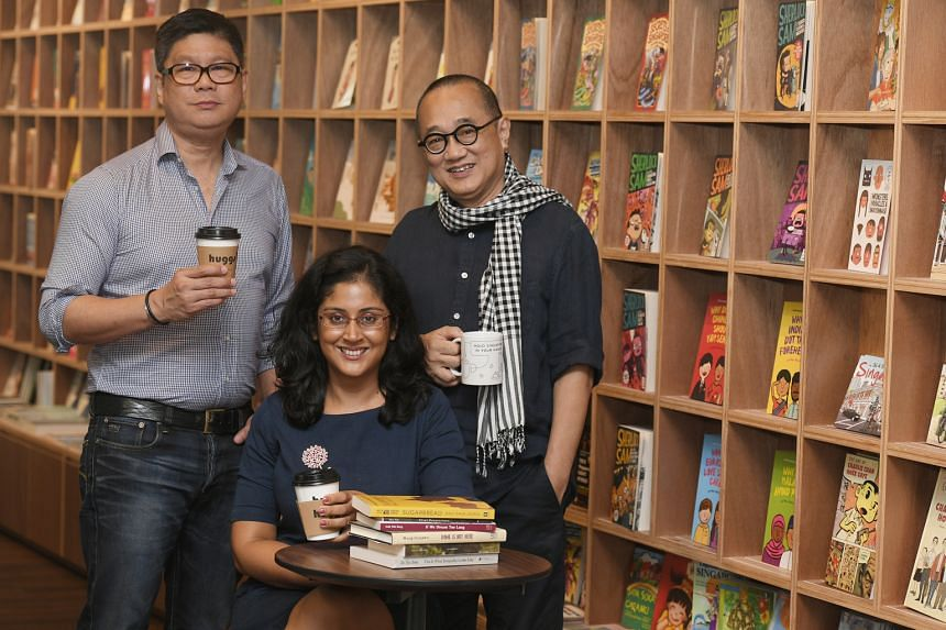 Mr Edmund Wee (right) and Mr Ron Choo (left) at Huggs- Epigram Coffee Bookshop, which sells only books that are about Singapore, brought out by local publishers or written by Singaporeans. Local author Balli Kaur Jaswal (seated) plans to work on her