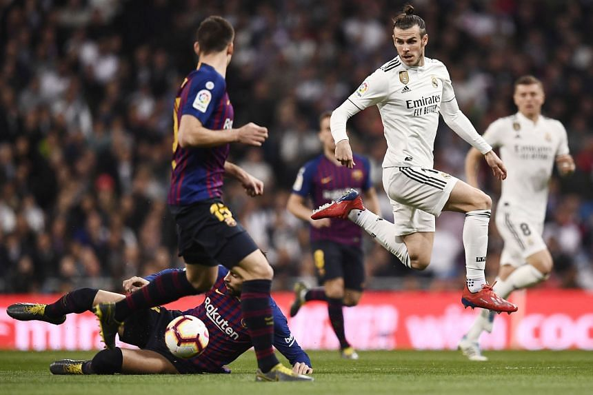 Real Madrid's Gareth Bale losing the ball to Gerard Pique during the 1-0 LaLiga defeat by Barcelona last Saturday. The Spanish media has reported that the Welshman is unpopular in the Real dressing room but his agent Jonathan Barnett has refuted thos