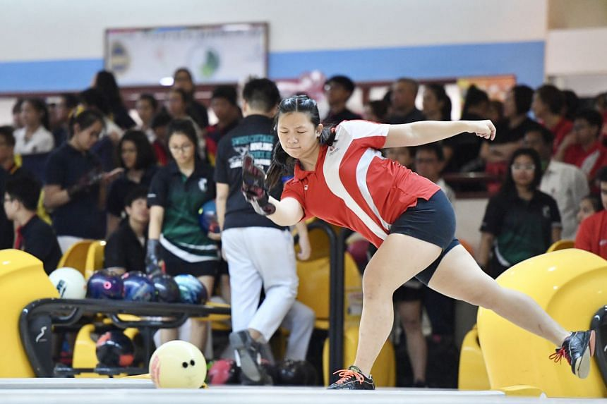 Singapore Sports School's Mandy Koh competing at the Schools National B Division bowling championships yesterday. She finished second in the all-events category, behind Methodist Girls' School's Arielle Tay, but was part of the SSP team who won the q