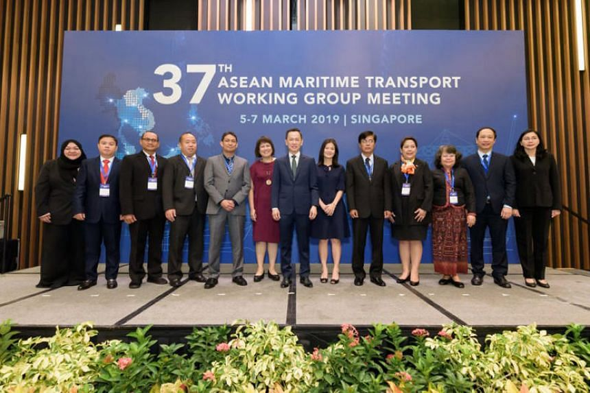 Mr Calvin Phua, Deputy Secretary (Hub Strategy) for Singapore's Ministry of Transport (centre), flanked by delegates at the 37th Asean Maritime Transport Working Group on March 5, 2019.