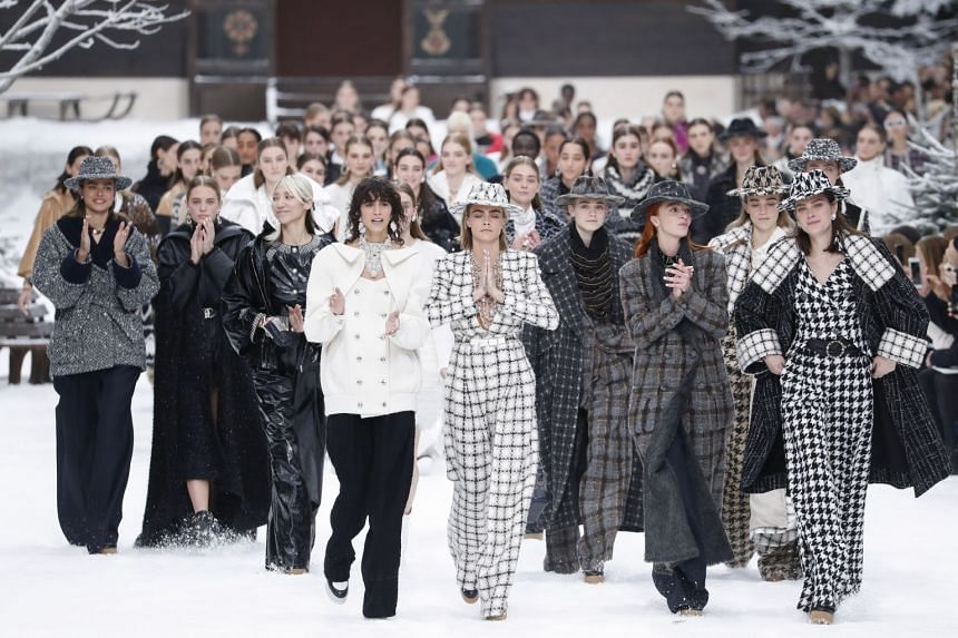 English model Cara Delevingne (centre) wears a creation as she leads other models on the runway of the Chanel show.