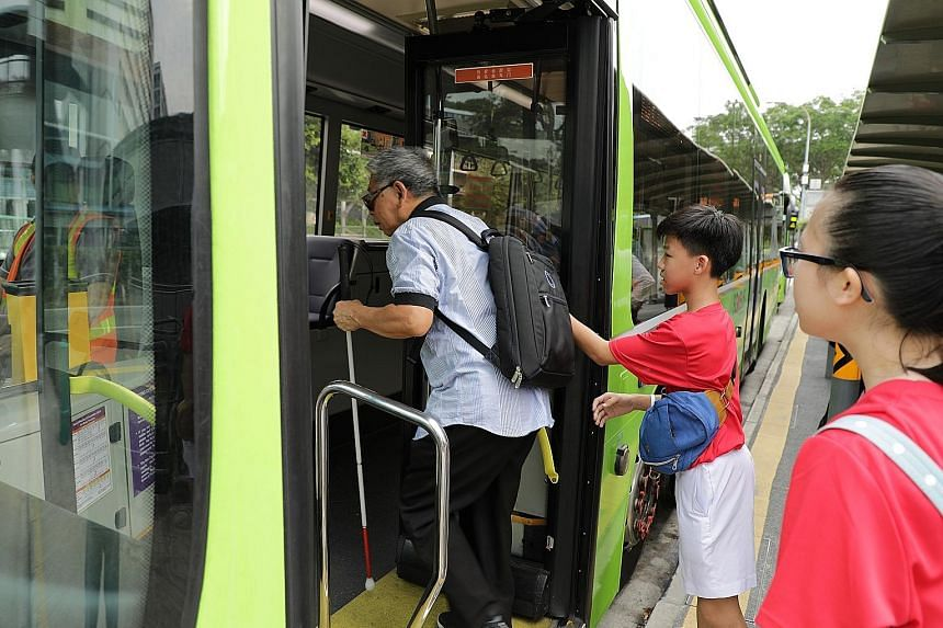 Students from Chung Cheng High School (Yishun) helping a commuter in Khatib board a bus safely.