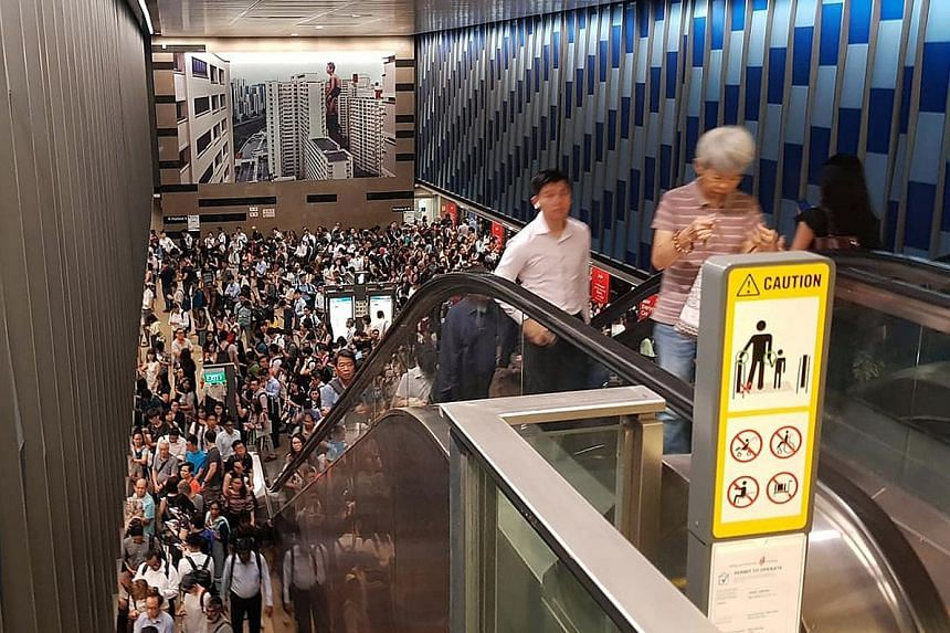 Commuters packing the Bukit Panjang MRT station yesterday. Service was delayed from as early as 7.45 am and operations started to return to normal just after 9am.