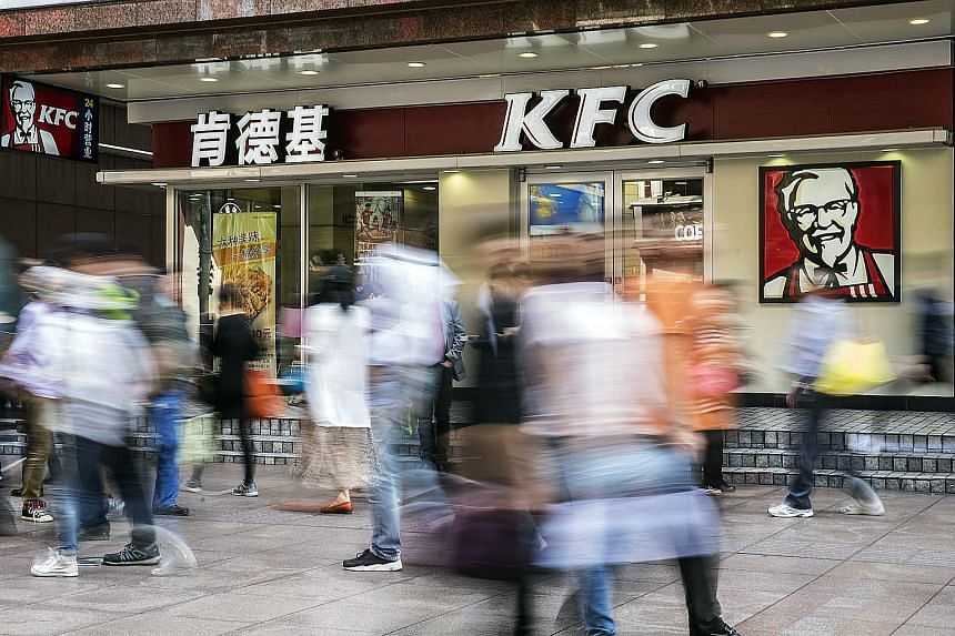 A KFC restaurant in Shanghai. Yum China has amassed a trove of spending and demographics data, allowing it to better forecast demand, cut food waste and boost profit margins. The savings have helped it avoid raising prices. A customer using the Smile