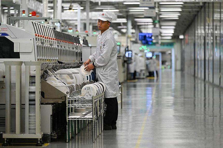 A Huawei mobile phone production line seen during a media tour of the company's state-of-the-art facilities in Dongguan, China's Guangdong province, yesterday.