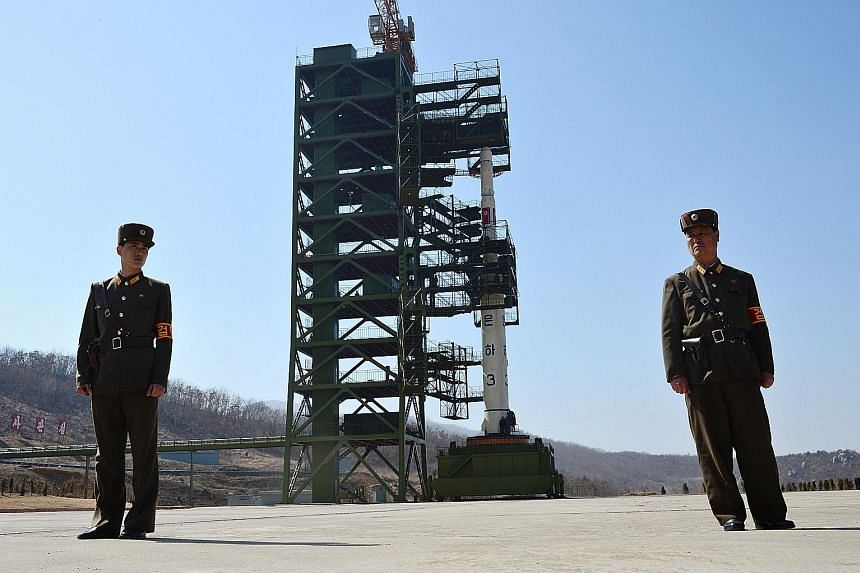 An April 2012 photo showing North Korean soldiers guarding the Unha-3 rocket at the Sohae satellite launch station. The site was partially dismantled as a goodwill gesture by Pyongyang last August.