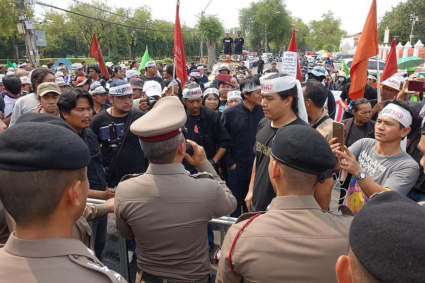 Thai police in a stand-off with protesters in Bangkok last week demanding that lawmakers in Parliament stop work. Ahead of Thailand's March 24 elections, civil rights activists argue that any new laws should be left to the next government. Lawmaker C