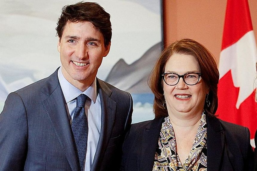 A file photo of Canadian Prime Minister Justin Trudeau with Ms Jane Philpott after she was appointed Treasury Board president. Ms Philpott stepped down on Monday, in a move seen as a major blow to the Prime Minister ahead of elections later this year