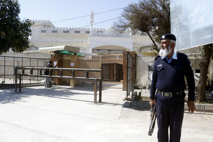 A private security guard stands outside a mosque allegedly administered by a banned outfit Jamat ud Dawa, after the authorities took administrative control of mosques and Islamic seminaries run by such groups, in Islamabad, Pakistan, on March 6, 2019
