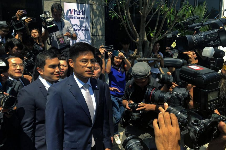 Thai Raksa Chart party leader Preechapol Pongpanich and members of his party leave the party headquarters to appear before the Constitutional Court in Bangkok, Thailand on March 7, 2019.