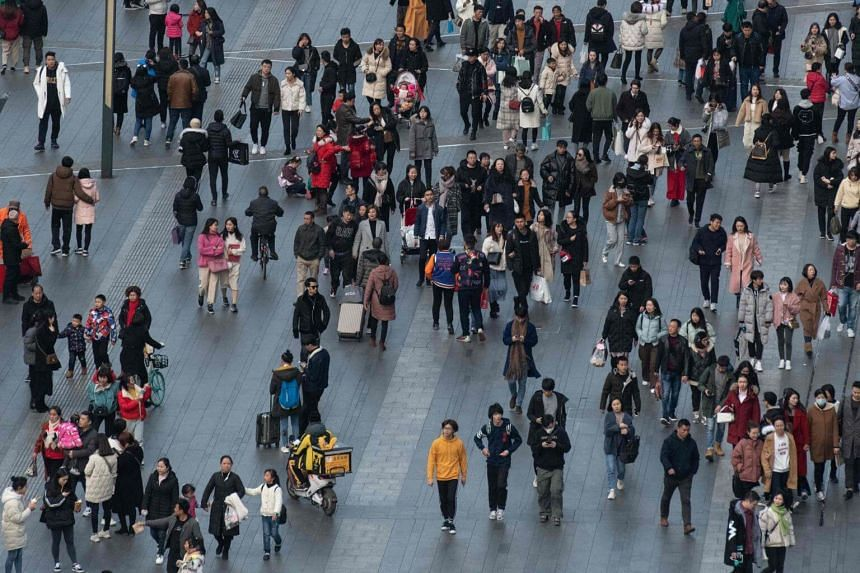 People walking in a tourist area in Chengdu, China's Sichuan province, on Feb 12, 2019.