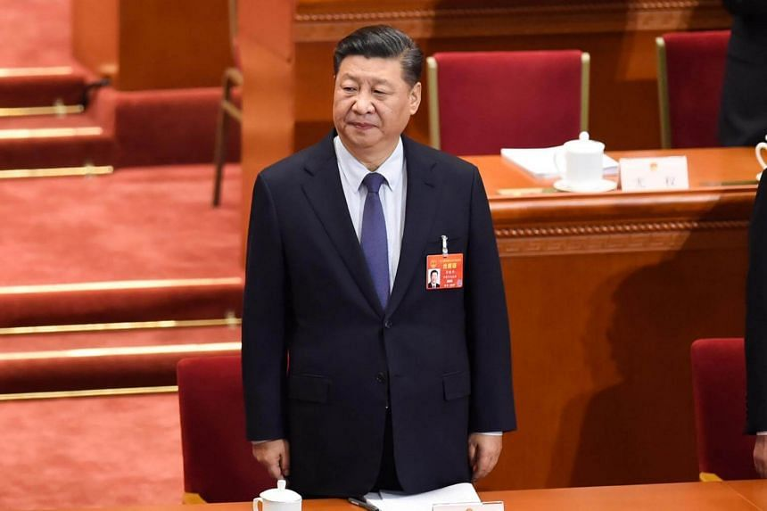 Chinese President Xi Jinping arrives for the opening session of the National People's Congress at the Great Hall of the People in Beijing, on March 5, 2019.