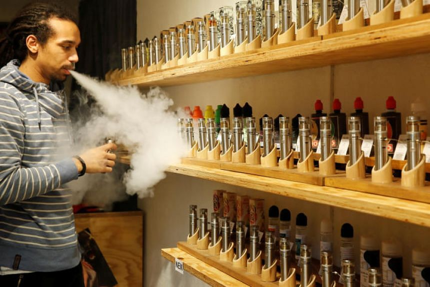 An employee demonstrates vaping at a tasting room for clients at the Dampfi e-cigarette store in Zurich, Switzerland, on Feb 1, 2019.