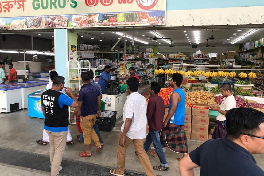 Affected construction workers from Stargood Construction heading to a minimart to collect their donated groceries on March 7, 2019.