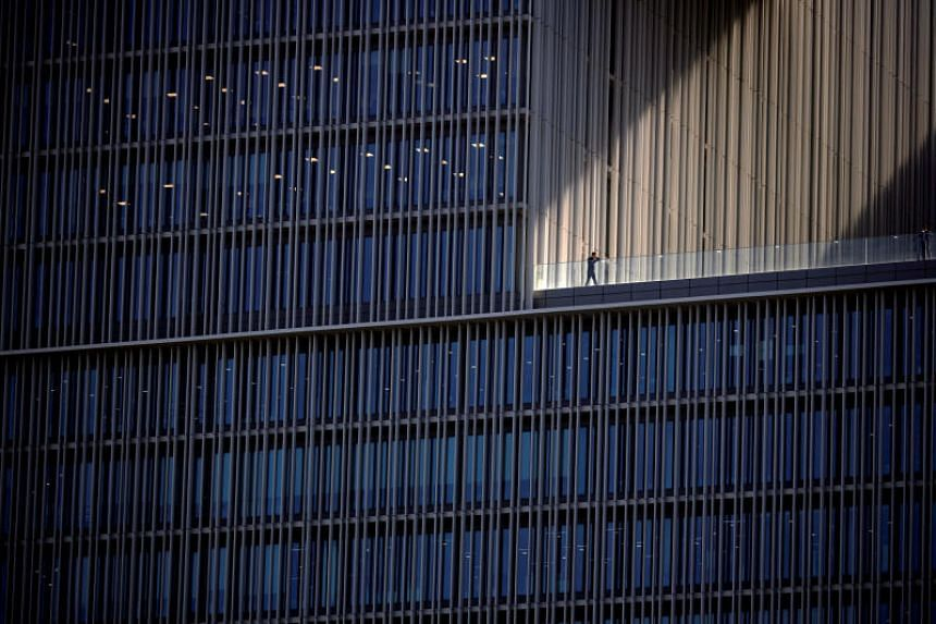 An employee talks on a phone at an office building in Seoul, South Korea, on Oct 2, 2018. South Korea has slashed the maximum number of working hours to 52 from 68.