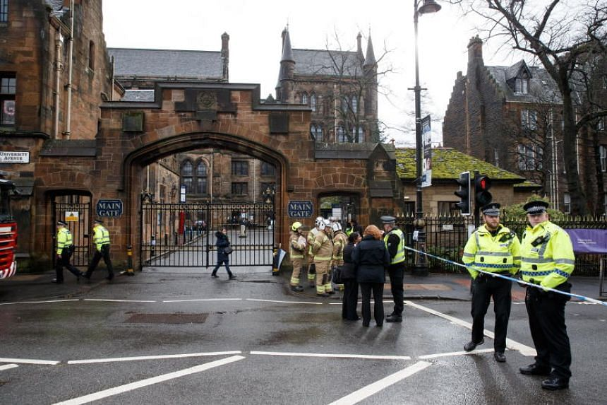 Authorities investigate a suspicious package reported to be in the Glasgow University mailroom, in Glasgow, Scotland, Britain, on March 6, 2019.