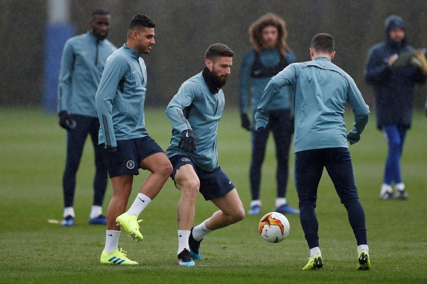 Chelsea's Olivier Giroud, Emerson Palmieri and Eden Hazard during training, on March 6, 2019 at Cobham Training Centre, Cobham, Britain.