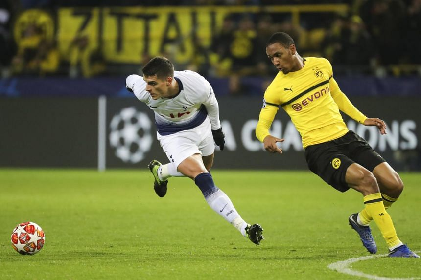 Tottenham's Erik Lamela (left) in action against Dortmund's Abdou Diallo during the Uefa Champions League round of 16, second leg soccer match between Borussia Dortmund and Tottenham Hotspur in Dortmund, on March 5, 2019.