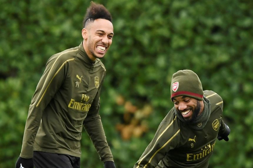 Pierre-Emerick Aubameyang (far left) and Alexandre Lacazette training in London ahead of Arsenal's Europa League match against Rennes. Aubameyang will likely lead the attack with his French teammate suspended.