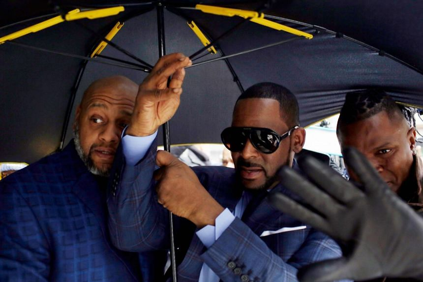 R. Kelly (centre) arrives at the Circuit Court of Cook County, Domestic Relations Division in Chicago, Illinois.