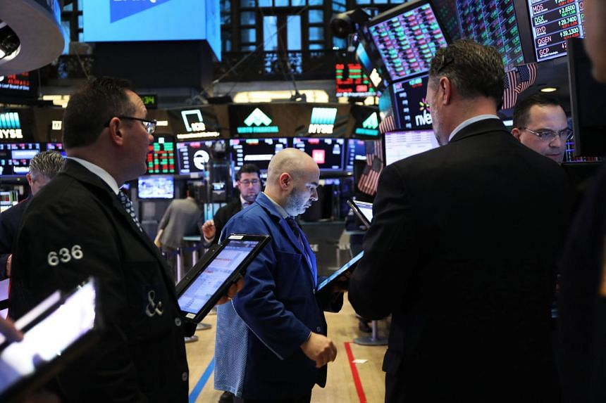 Traders work on the floor of the New York Stock Exchange on March 4, 2019.