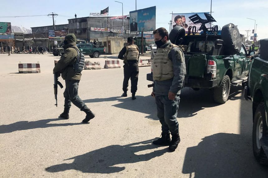 Policemen keep watch near the site of an attack in Kabul on March 7, 2019.