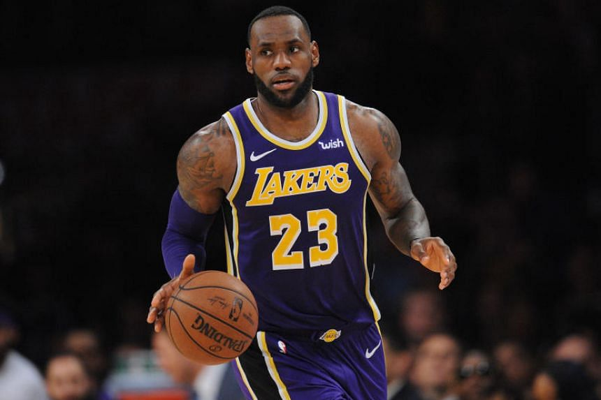 d9f970549be Los Angeles Lakers forward LeBron James moves the ball against the Denver  Nuggets during the second