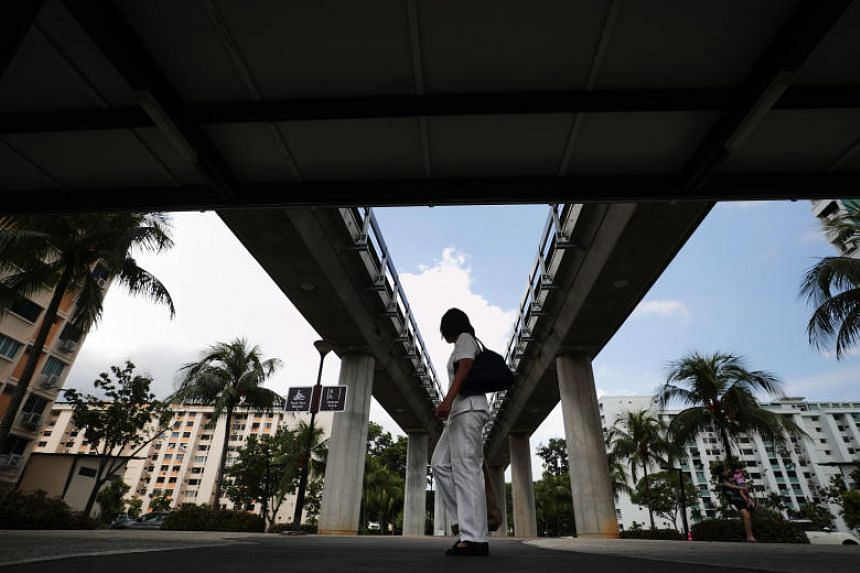 A sheltered walkway under the MRT track near Simei station.